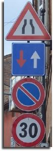 road narrows 30kph road sign italy